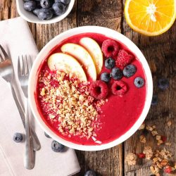 Smoothie bowl with berries, nuts and seeds