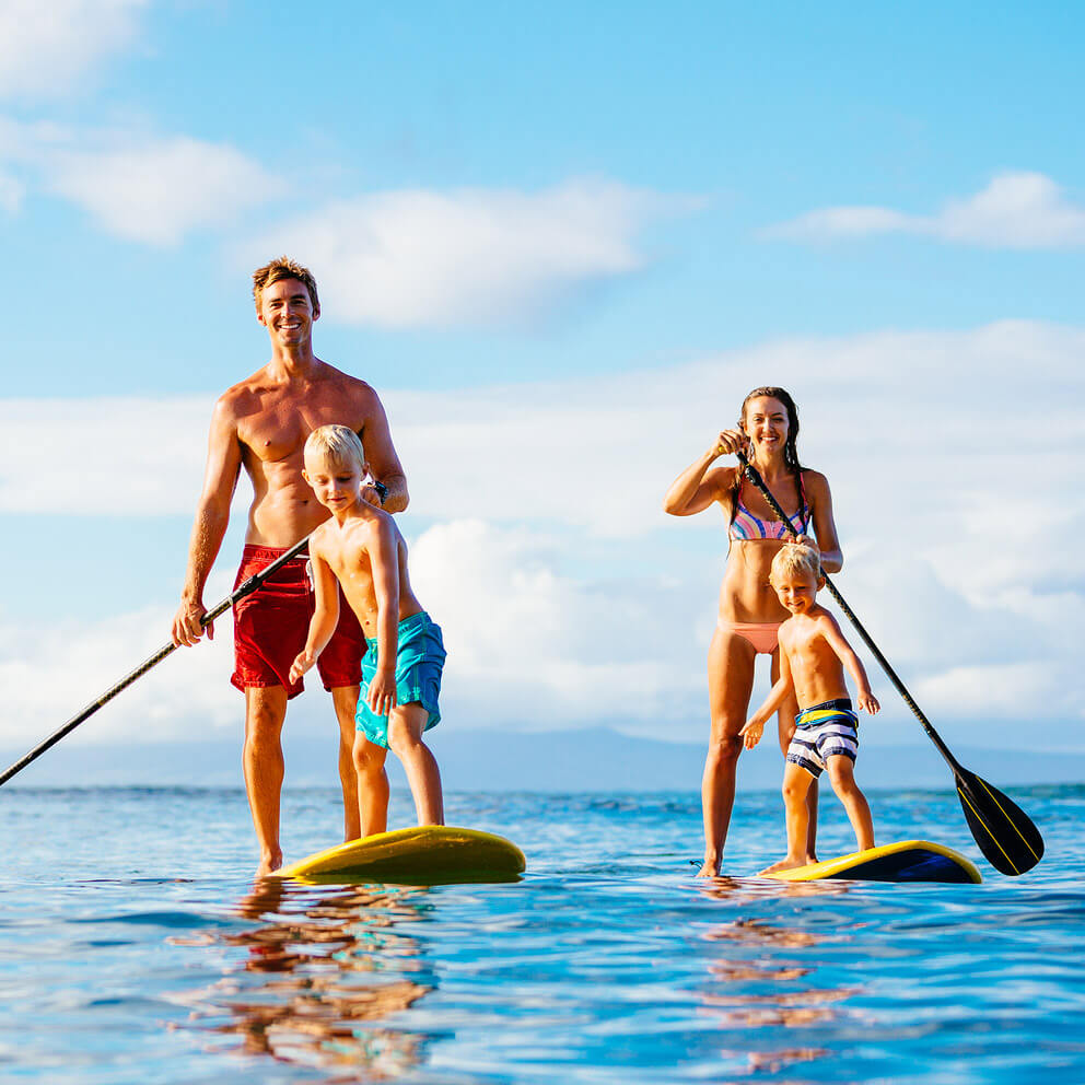 Family Paddle Boarding while on a day cruise to the Marietas Islands